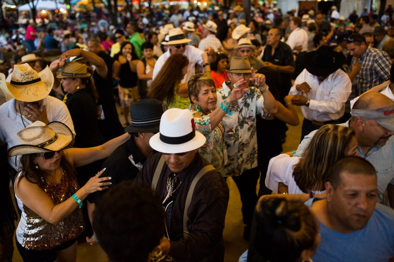 A packed floor of dancers fill the area during the Conjunto Festival. Photo by Scott Ball.