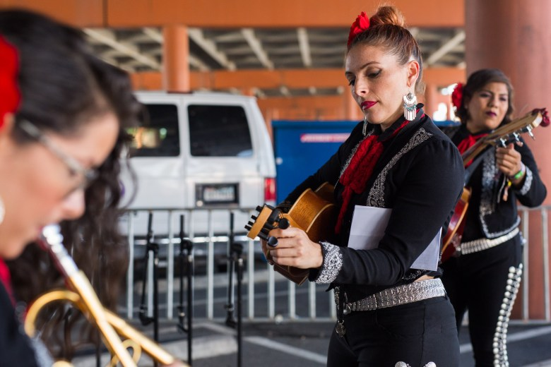 Members of Flor De Toloache warm up before heading on stage. Photo by Scott Ball.