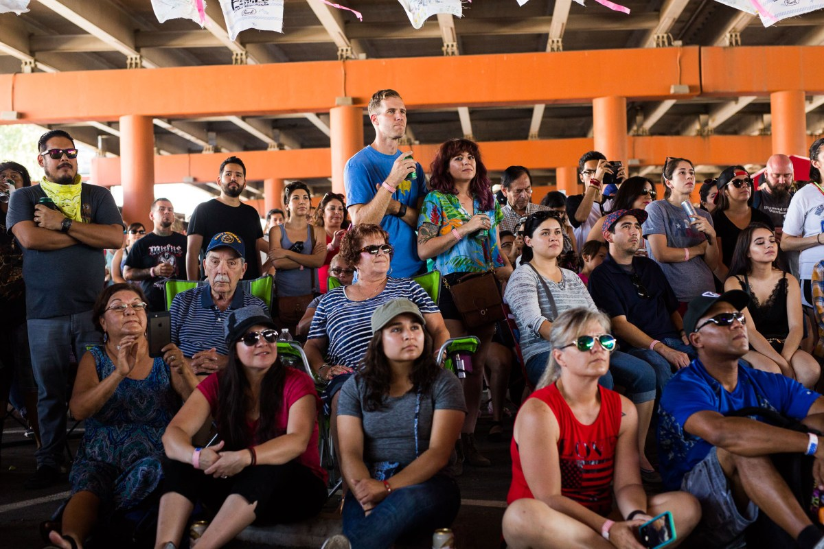 Attendees stack in front of the stage to listen to Flor De Toloache. Photo by Scott Ball.