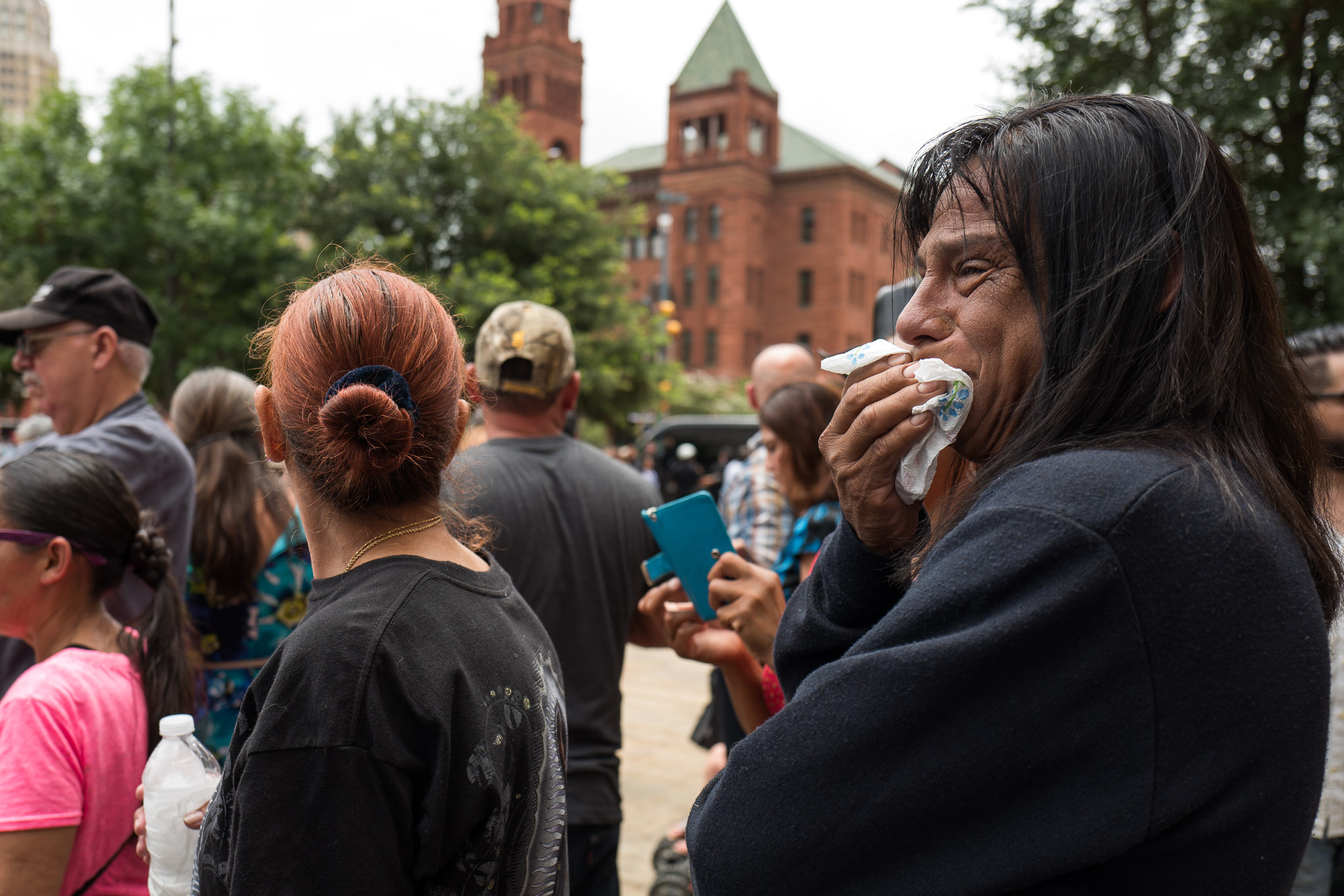 An attendee cries as the hearse carrying Emilio Navaira's body arrives. Photo by Scott Ball.