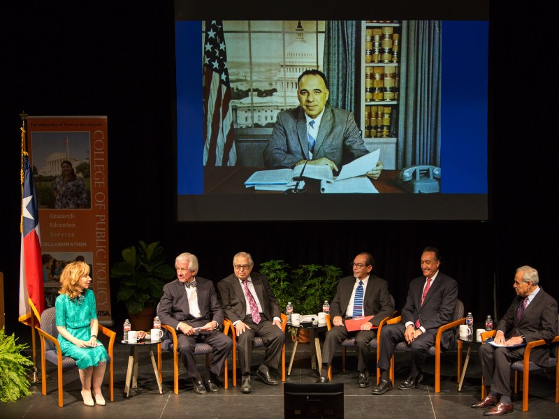 Moderator Dr. Francine Romero introduces panelists (left to right) Lionel Sosa, Gene Rodriguez, Dr. Henry Flores, Dr. Henry Cisneros, and Charles Gonzalez. Photo by Scott Ball.