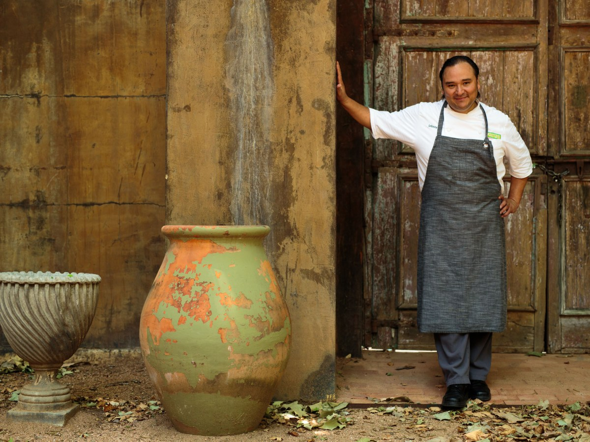 Chef Johnny Hernandez stands for a photo at his home. Photo by Scott Ball.