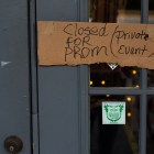 A cardboard sign shows that La Botánica is closed for the prom. Photo by Scott Ball.
