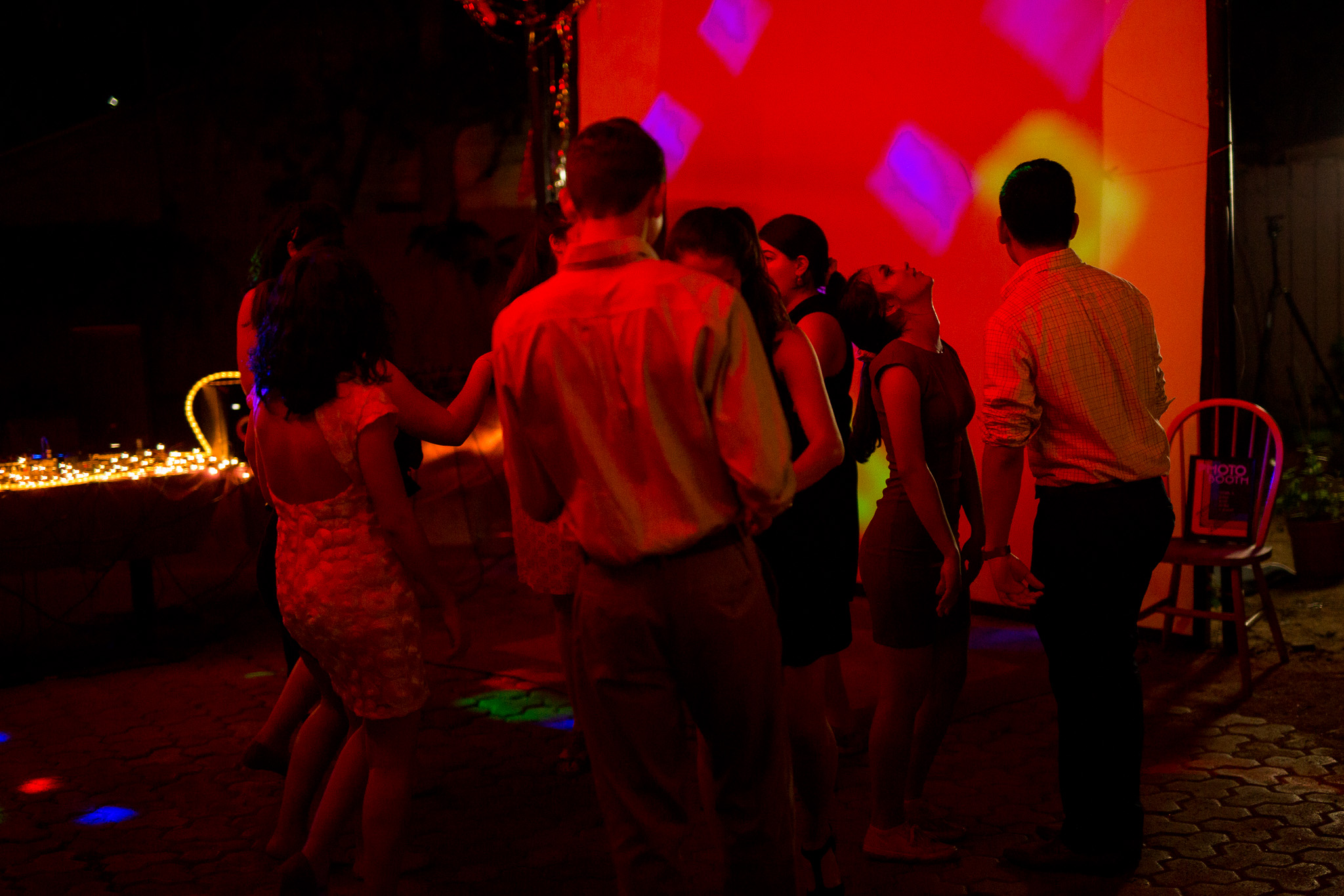 Prom attendees dance during a DJ set featuring many songs by Selena. Photo by Scott Ball.