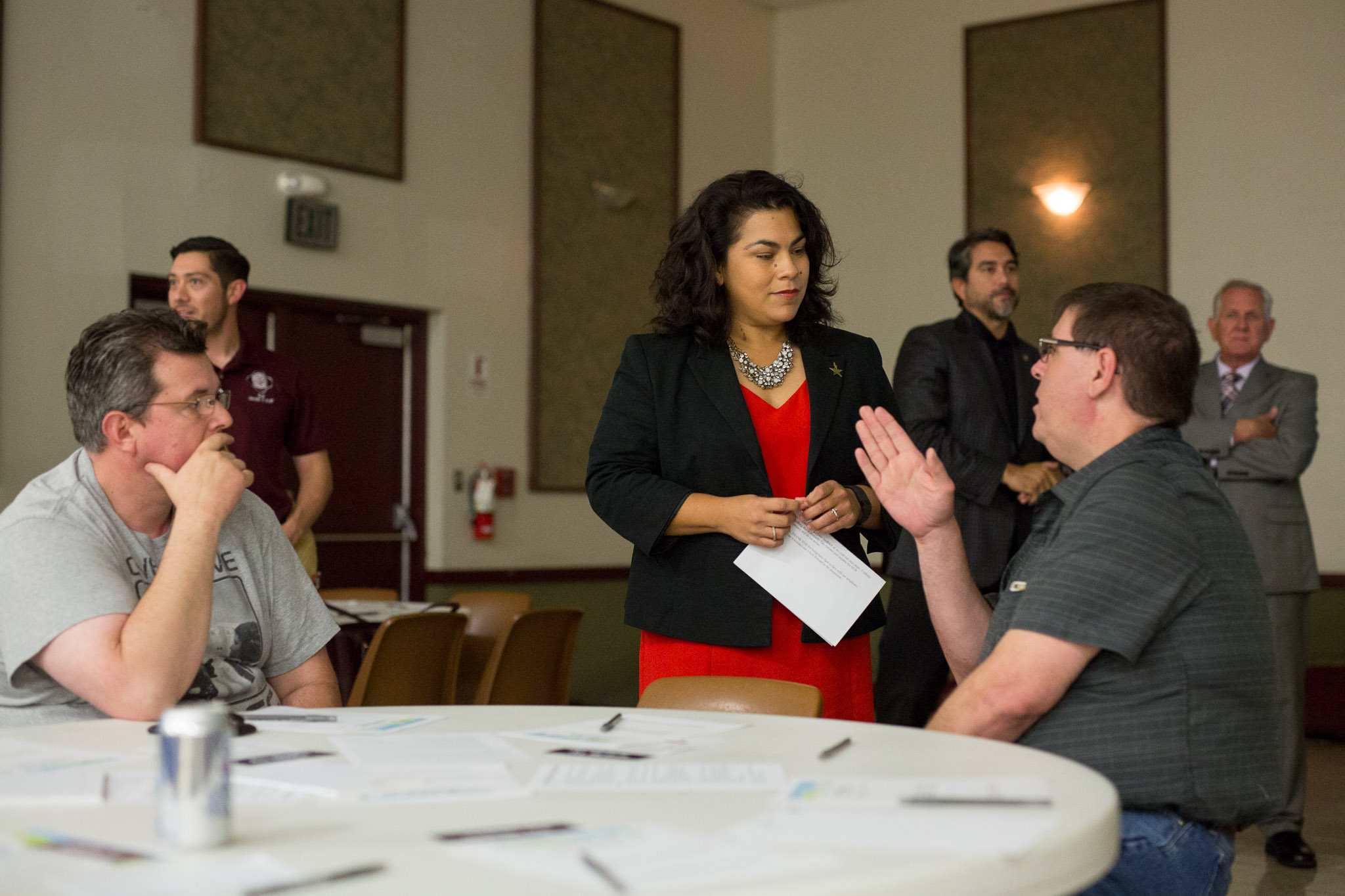 Councilwoman Rebecca Viagran (D3) speaks with community members before the event. Photo by Scott Ball.