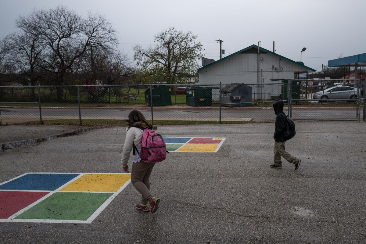 Children walk through an after school play area outside Stewart Elementary School. Photo by Scott Ball.