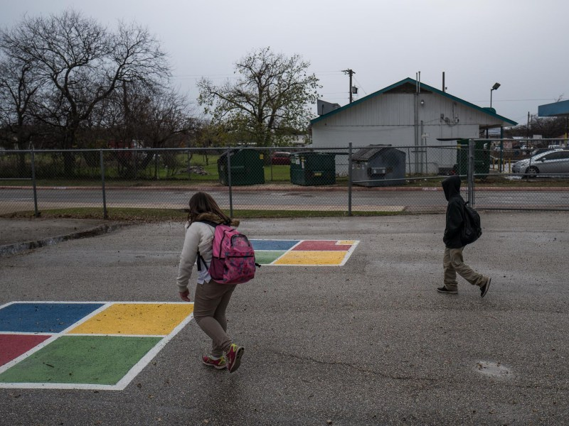 Children walk through an after school play area outside Stewart Elementary School. Photo by Scott Ball.