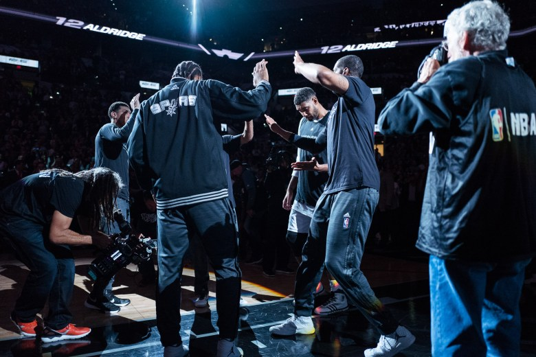 The San Antonio Spurs starting lineup comes together after being announced. Photo by Scott Ball.