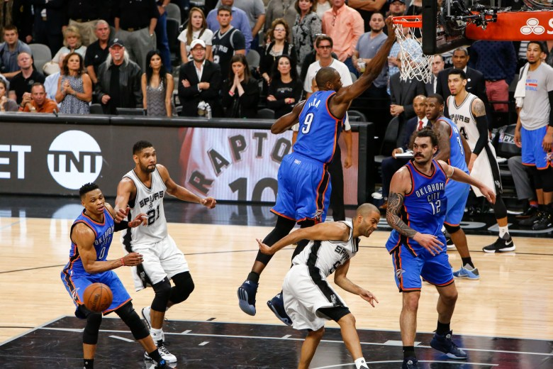 Spurs Guard #8 Tony Parker makes a behind the back pass to #12 LaMarcus Aldridge for a three point shot. Photo by Scott Ball.
