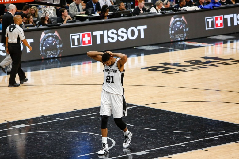 Spurs Forward Tim Duncan holds his head as he waits for the next play. Photo by Scott Ball.