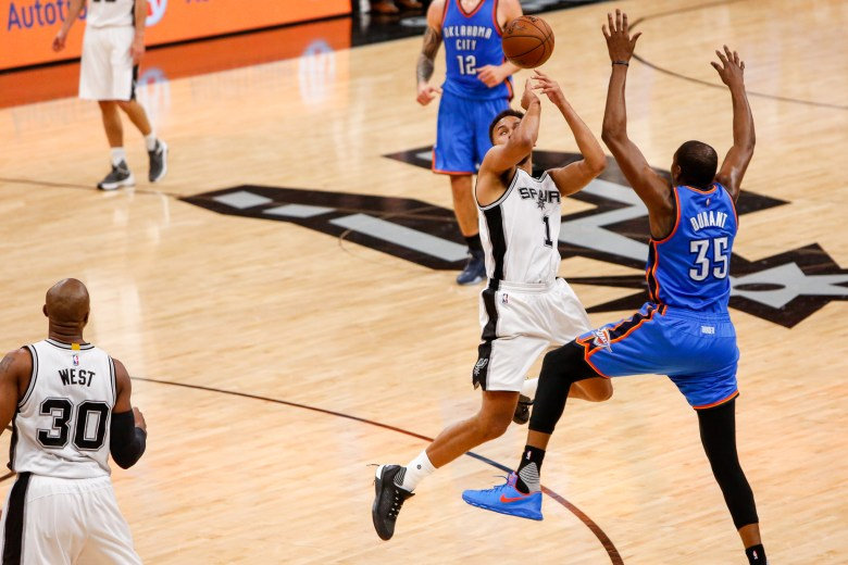Spurs Forward #1 Kyle Anderson is blocked by Thunder Forward #35 Keven Durant. Photo by Scott Ball.