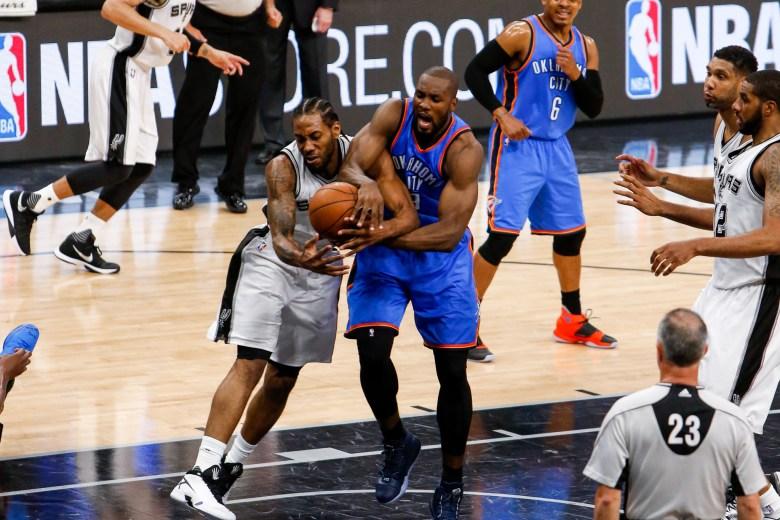 Spurs Forward #2 Kawhi Leonard steals the ball from Thunder Forward #9 Serge Ibaka. Photo by Scott Ball.