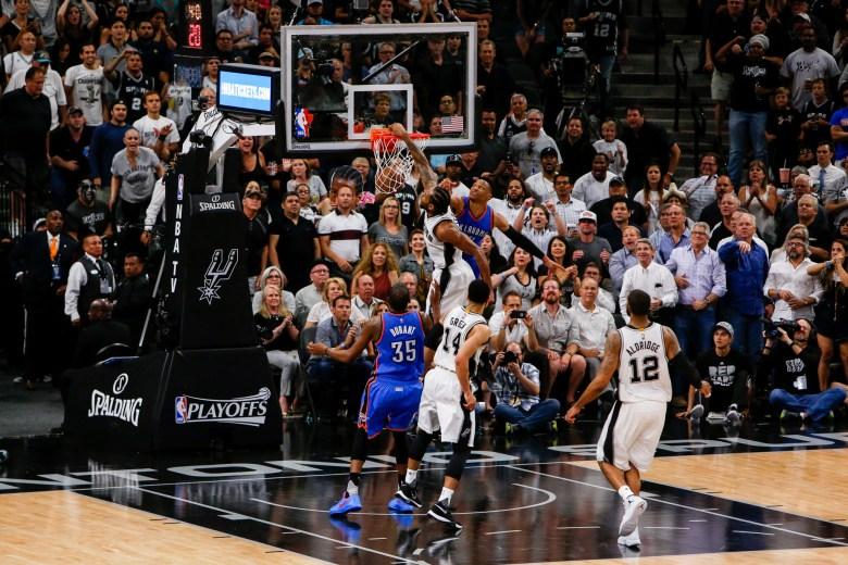 Spurs Forward #2 Kawhi Leonard slams the ball late in the fourth quarter. Photo by Scott Ball.