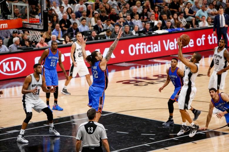 Spurs Guard #9 Tony Parker takes a jump shot over Thunder Center #12 Steven Adams. Photo by Scott Ball.