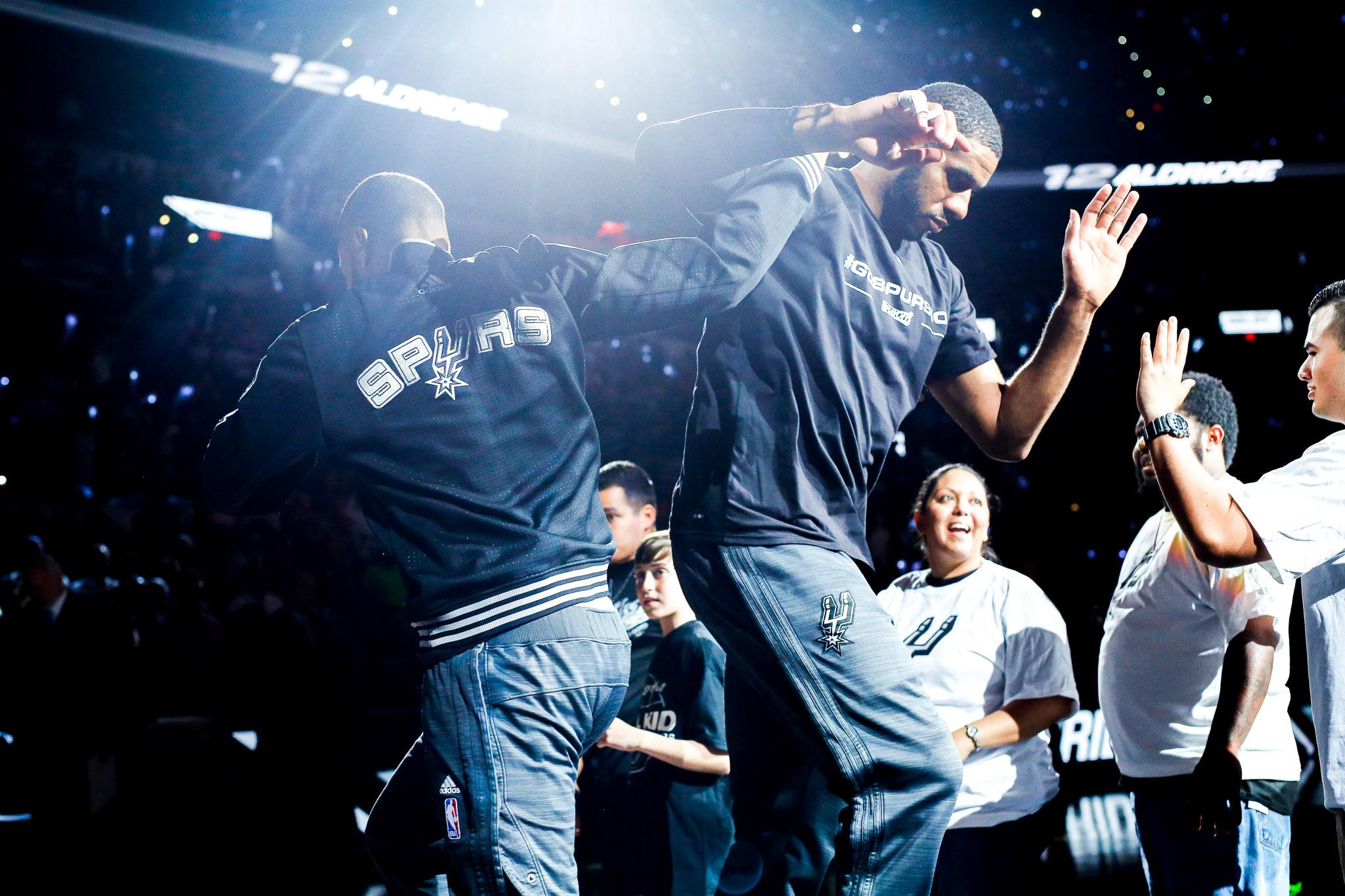 Spurs Forward #12 LaMarcus Aldridge walks through his teammates as he is introduced. Photo by Scott Ball.