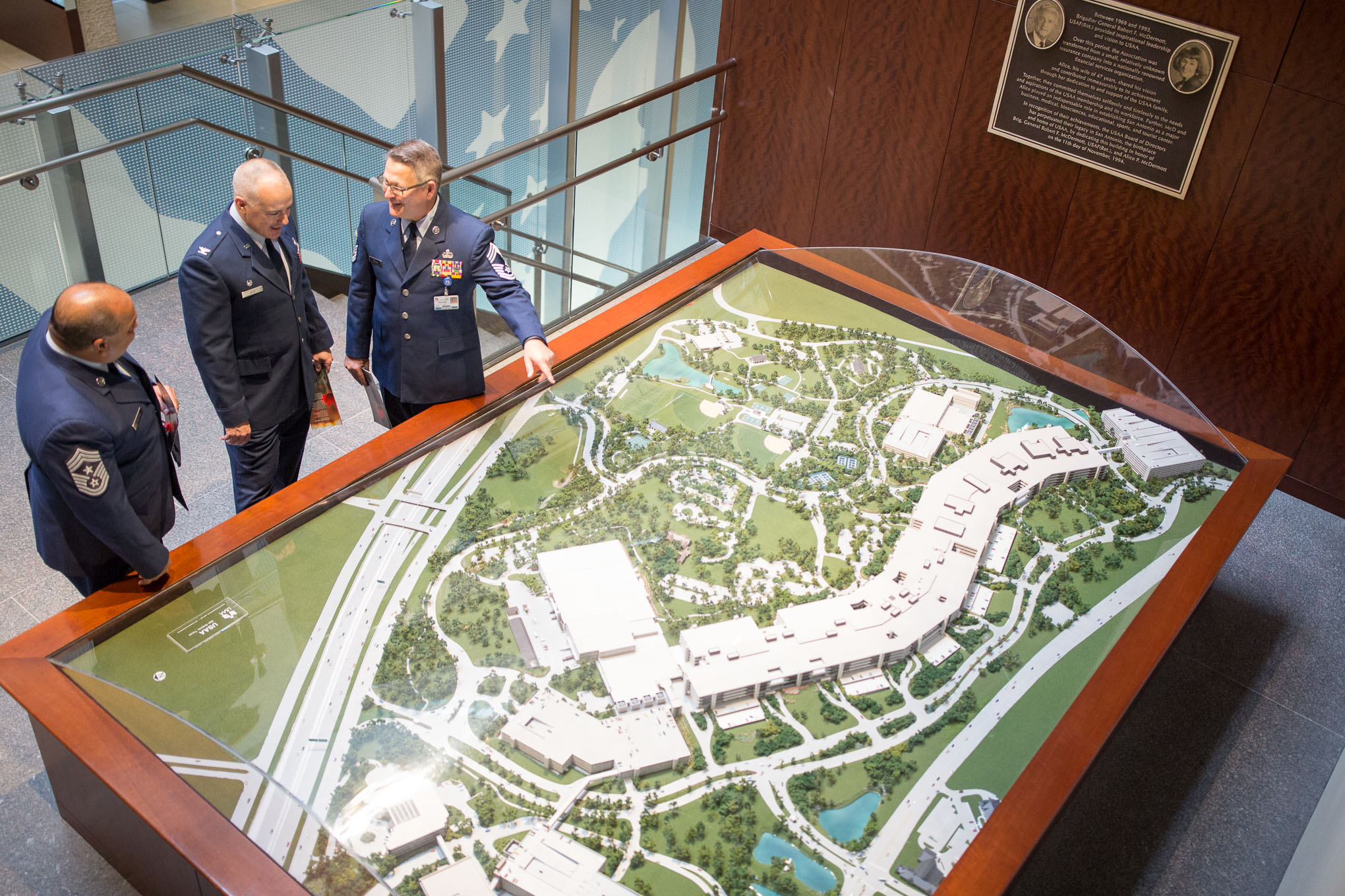 Members of the United States Air Force overlook a large model representing the USAA headquarters. Photo by Scott Ball.