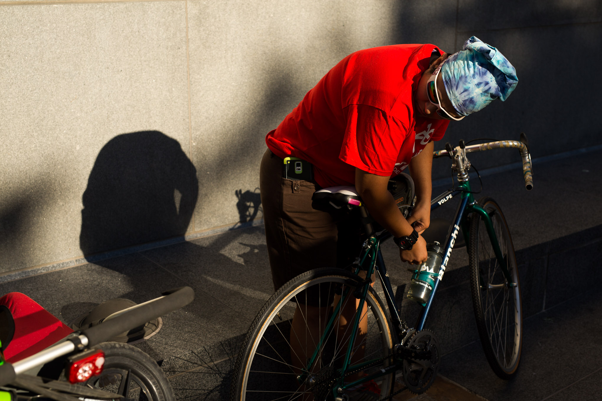 Earnabike supporter Natalie Alvarado locks her bike as she arrives to Main Plaza. Photo by Scott Ball.