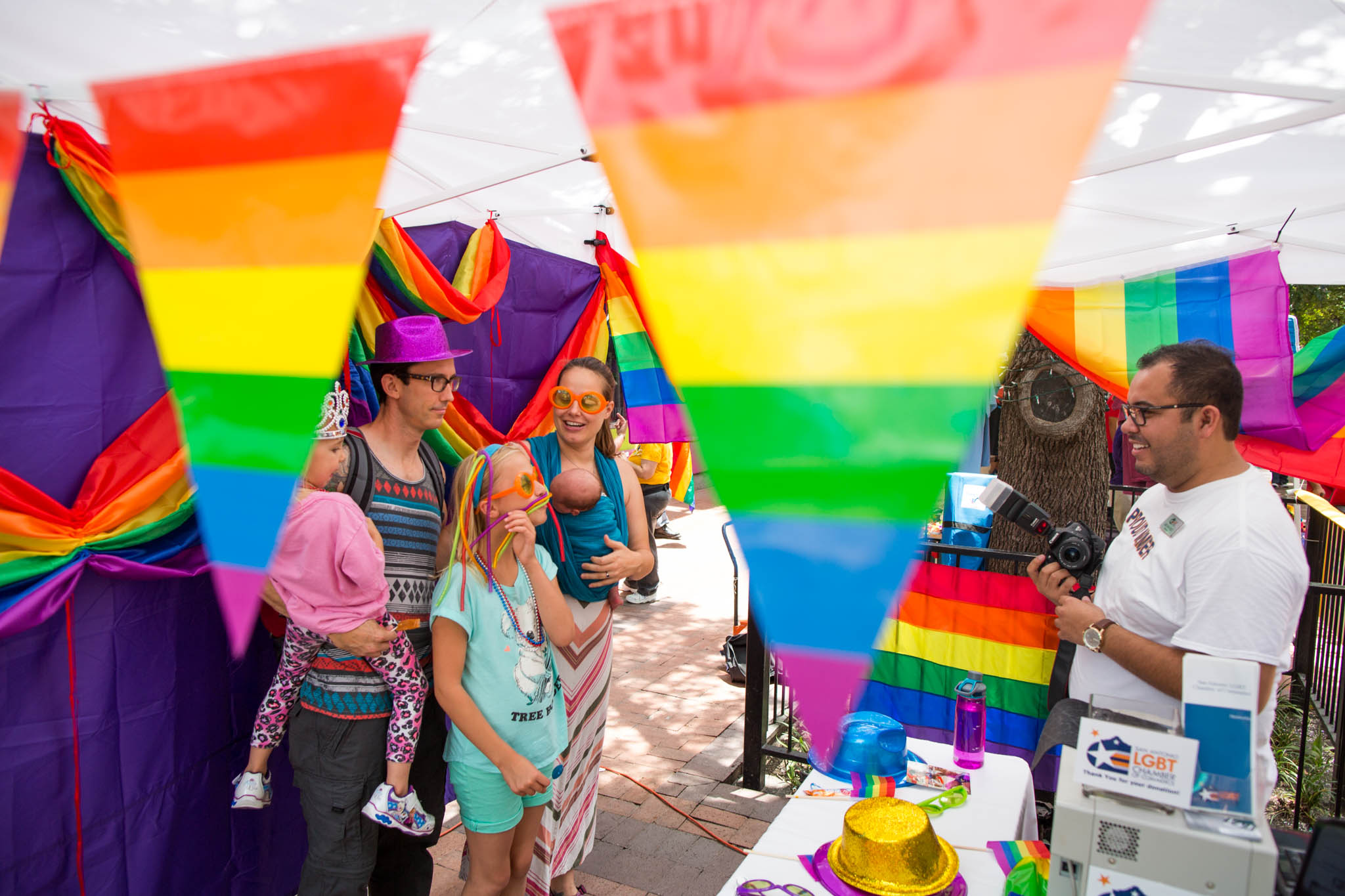 A family poses for a photo during the Family Pride Fair. Photo by Michael Cirlos.