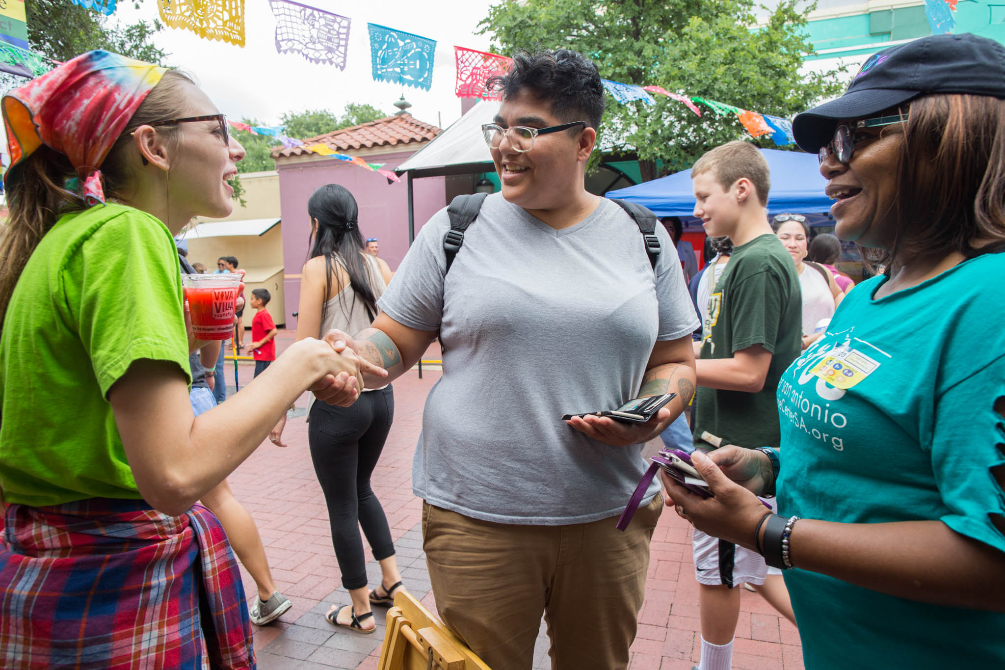 Alyson Alonzo (middle) greets fans as they congratulate her performance at the Family Pride Fair. Photo by Michael Cirlos.