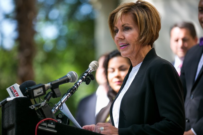 City Manager Sheryl Sculley announces the terms of agreement for new labor contract with the police union. Photo by Kathryn Boyd-Batstone.