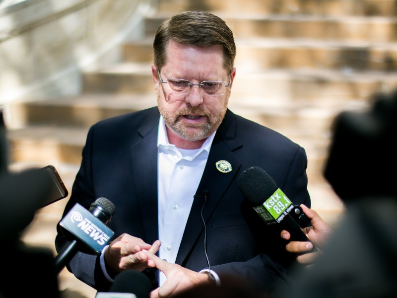 SAPOA President Mike Helle speaks with reporters about the specify of the new police union labor contract. Photo by Kathryn Boyd-Batstone.