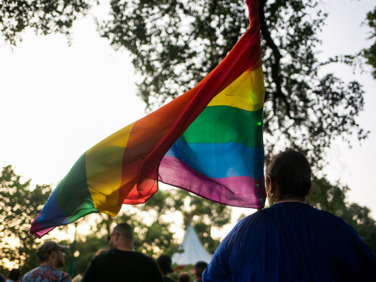 A Pride flag during the candle light vigil. Photo by Kathryn Boyd-Batstone.