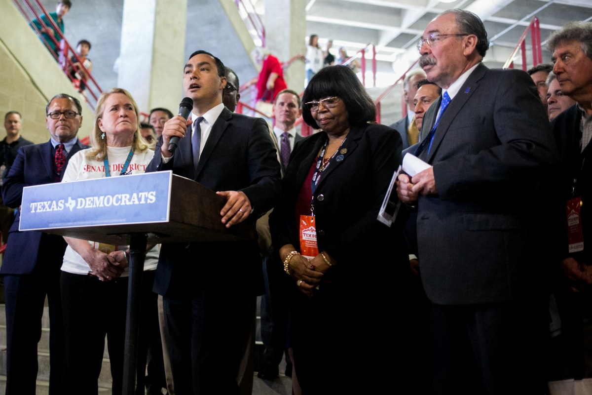 Texas Democratic Convention Chair Joaquin Castro gathers House and Senate members to stand together in protest of Donald Trump. Photo by Kathryn Boyd-Batstone.
