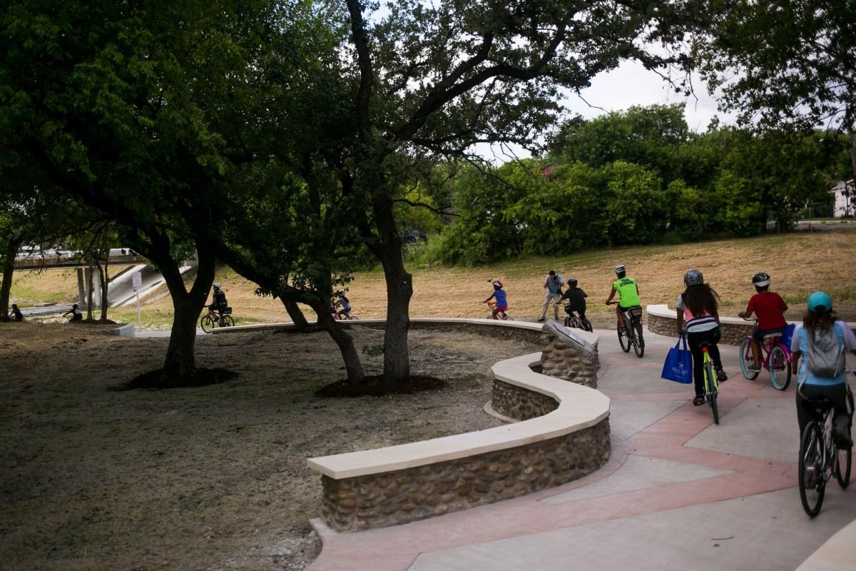 Bikers christen the new Alazán Creek Linear Trail. Photo by Kathryn Boyd-Batstone.