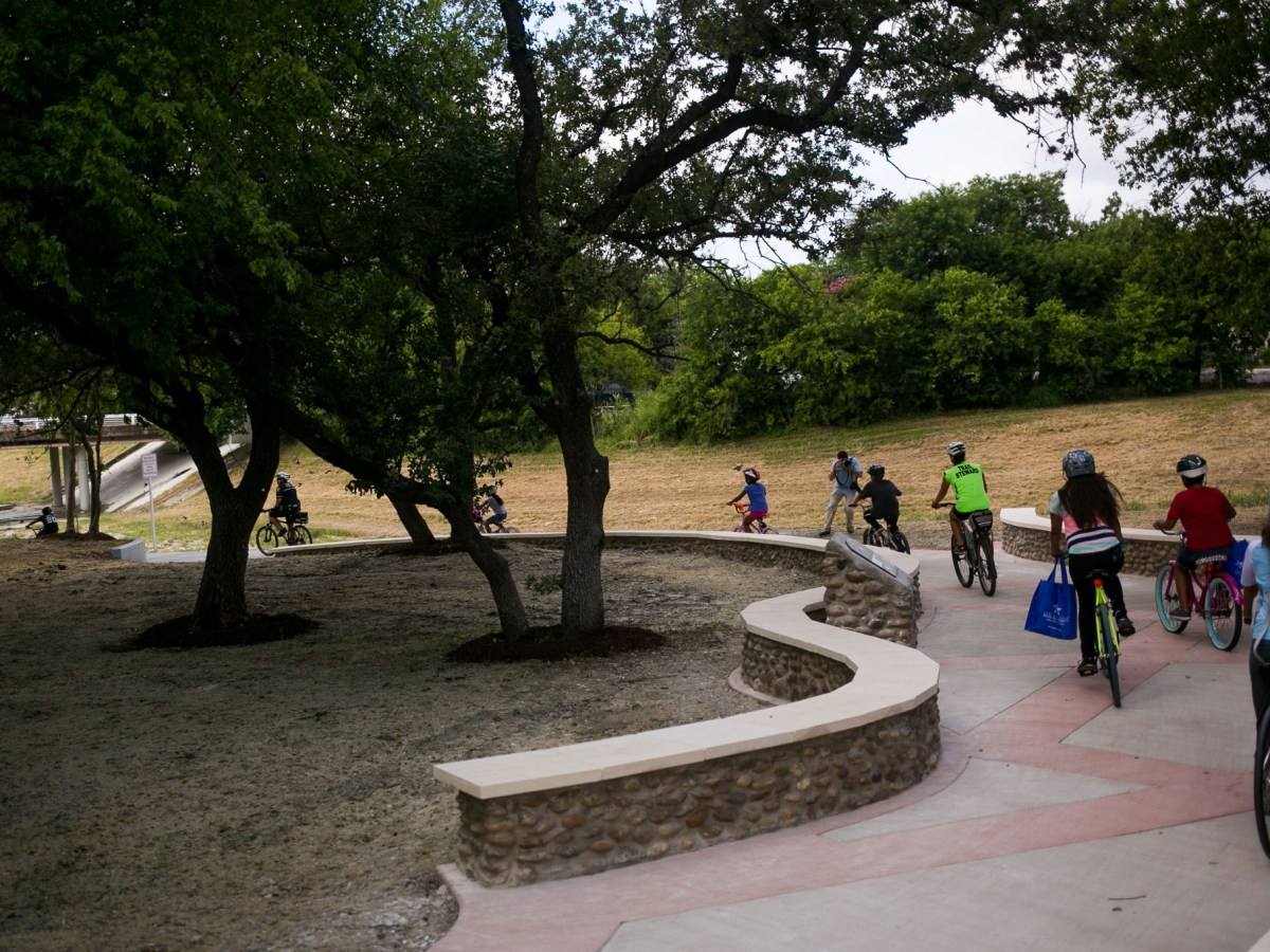 Bikers christen the new Alazán Creek Linear Trail. Photo by Kathryn Boyd-Batstone.