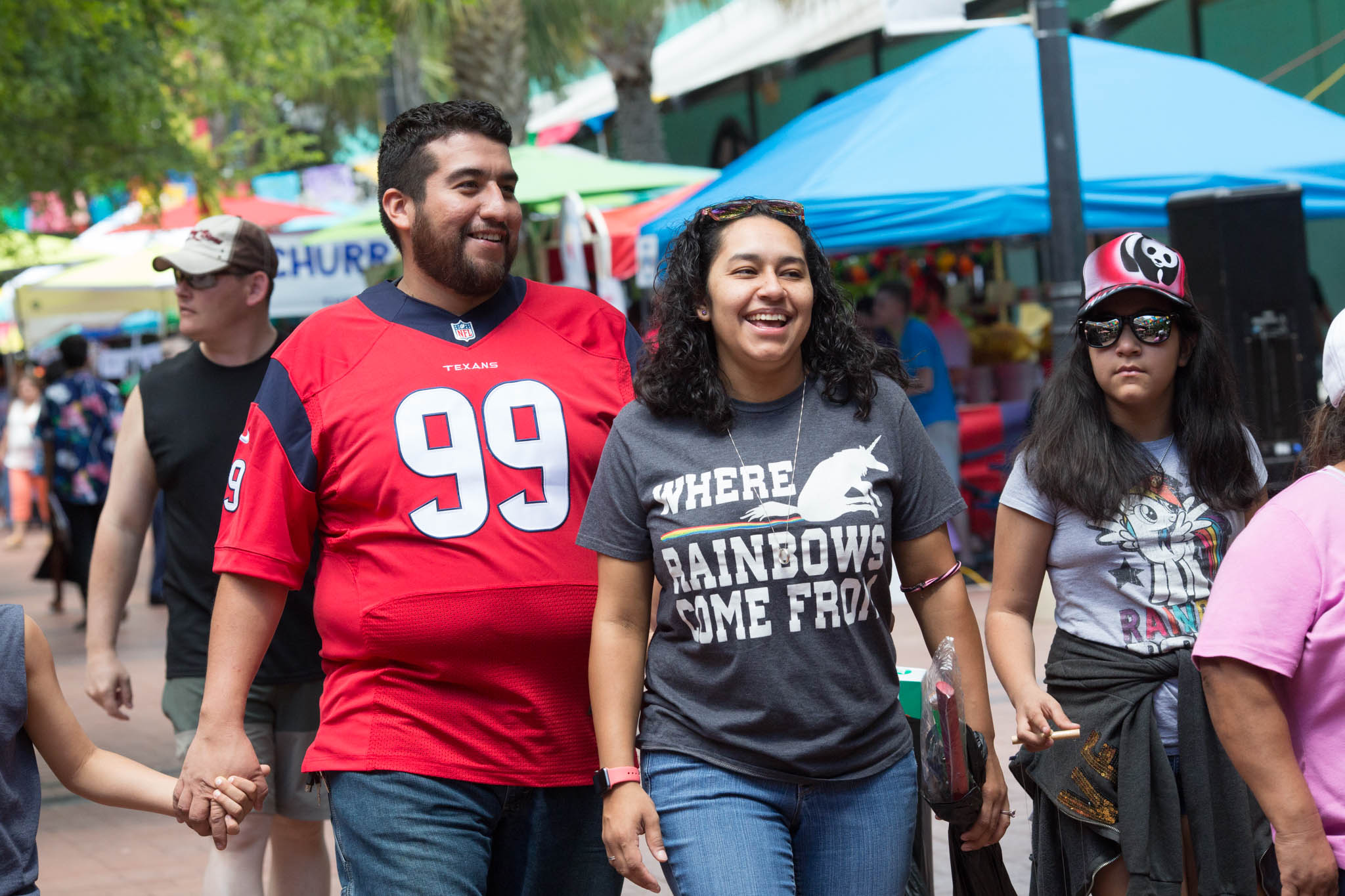 Friends and family stroll through the Family Pride Fair on Saturday. Photo by Michael Cirlos.