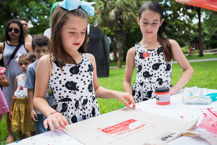 Vanessa Guerra (left) makes a screen print as her sister Isabella watches. Photo by Michael Cirlos.