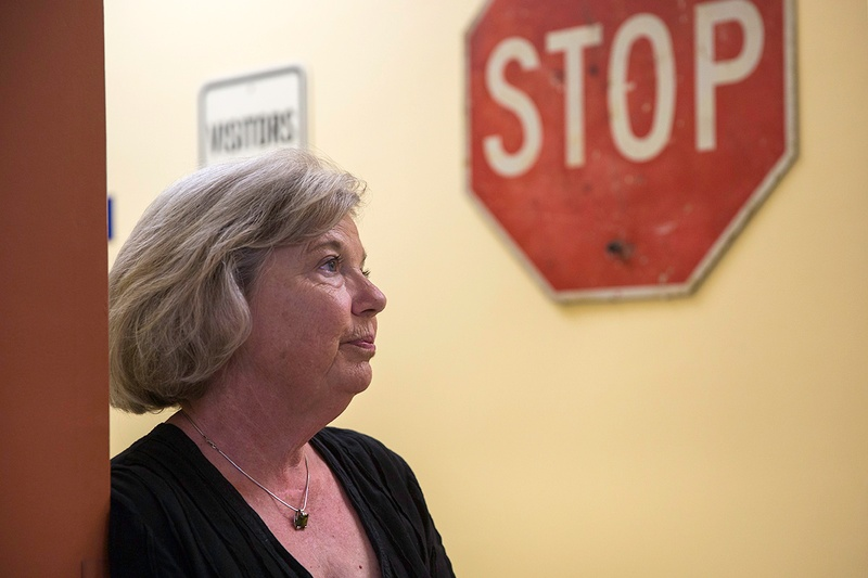 Sharon Fry, who owns Fry Auto Title Service in South Austin with her husband, is worried about a Texas Department of Motor Vehicle proposal to regulate the fees her business can charge. Photo by Qiling Wang for the Texas Tribune.
