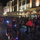Cyclists ride through downtown Puebla, Mexico, during a Midnight Bike Tour. Photo by Roberto Treviño.