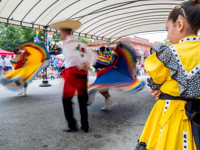 A young dancer watches a Ballet Folklorico performance during the Family Pride Fair. Photo by Michael Cirlos.