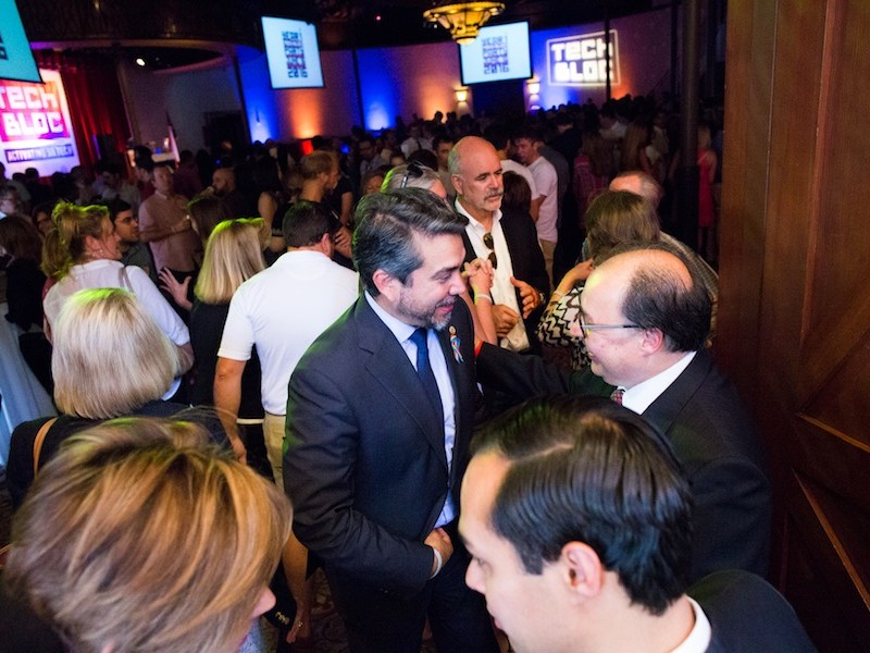 Councilman Roberto Treviño (D1) speaks with San Antonio Hispanic Chamber of Commerce President and CEO Ramiro Cavasos before the event begins. Photo by Michael Cirlos.