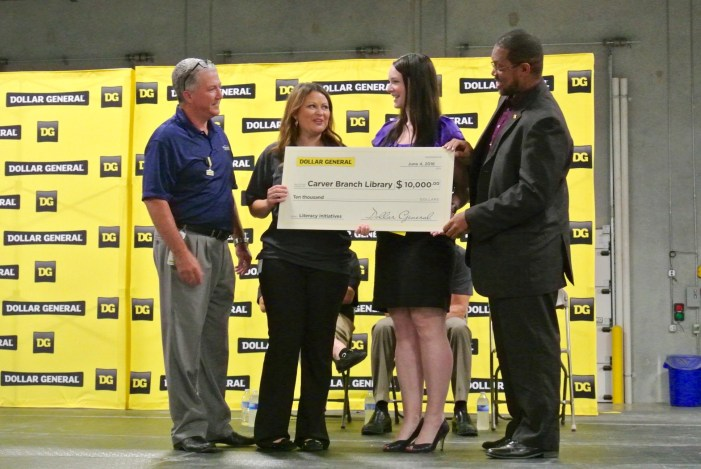 Dollar General Donates $10,000 to the Carver Branch Library to Celebrate the Opening of its new San Antonio Distribution Center. From left: Mario Tort, Director, San Antonio Distribution Center; Lindsey Sublett, Dollar General; Dianna Morganti, San Antonio Public Library; D.L. Grant San Antonio Public Library.  Photo by Sarah Talaat.