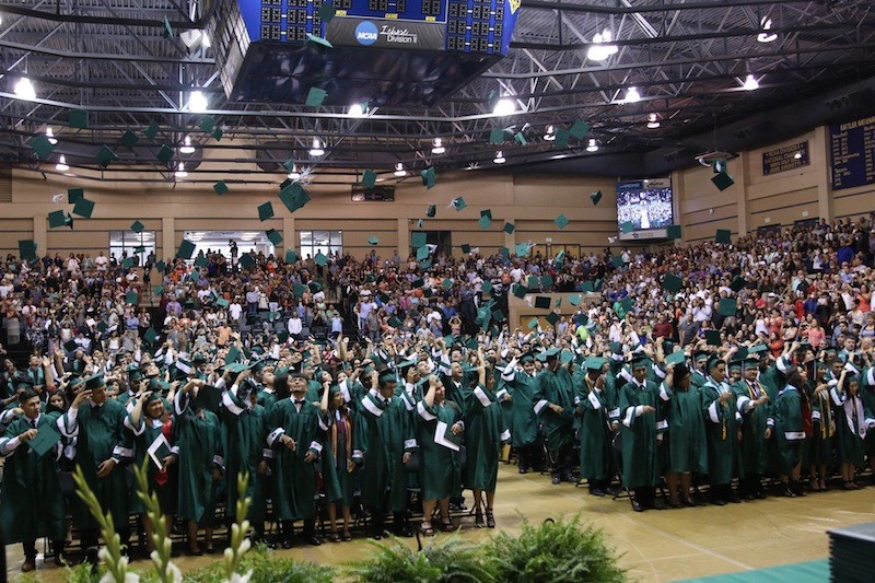 Students of Kennedy High School's Class of 2016 throw their caps into the air after their graduation ceremony. Photo courtesy of Edgewood ISD.