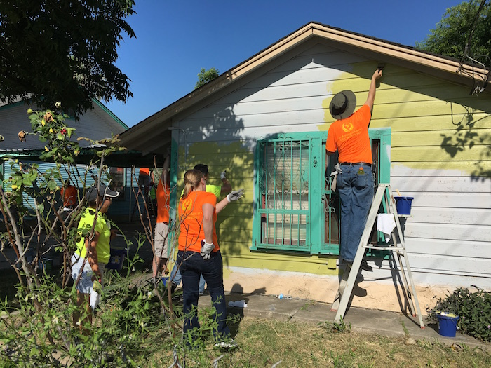 Volunteers participate in a beautification project in the Lanier High School neighborhood during H-E-B's Tournament of Champions. Photo by Bekah McNeel