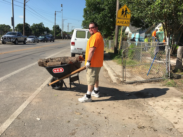 A volunteer helps with a beautification project in the Lanier High School neighborhood during H-E-B's Tournament of Champions. Photo by Bekah McNeel