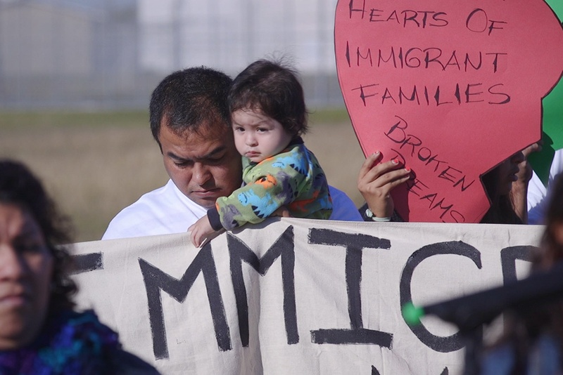 Immigrants and activists participate in press conference and rally before the kick-off of a 37-mile march on Nov. 19, 2015, The march is designed to show their support for immigration reform. The marchers planned to walk for three days, from the federal immigration detention facility in Taylor to the Texas Governor's Mansion in downtown Austin. Photo by Todd Wiseman.