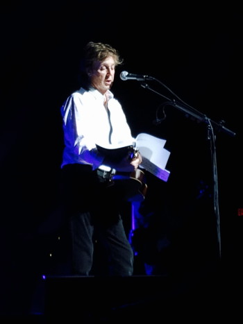 Di Maio hands her manuscript to artist Paul McCartney at the Tobin Center back in 2014. Photo courtesy of Camille Di Maio.