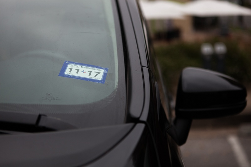 A vehicle with a Texas registration sticker. Photo by Shelby Knowles for The Texas Tribune.