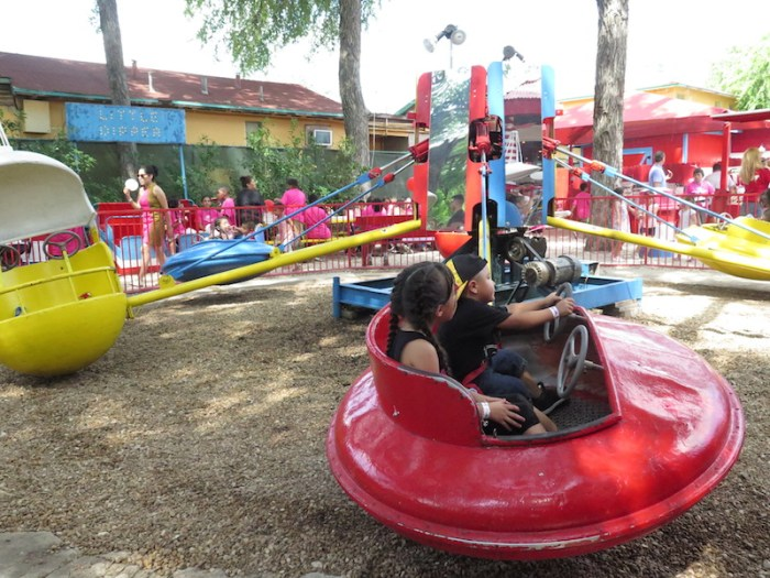 Two kids wait for a ride at Kiddie Park to start.  Photo by Katie Walsh.