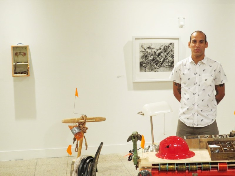 Curator Andrei Renteria in the exhibition Los de Abajo: Garbage as an Artistic Source. Photo by David Rubin.