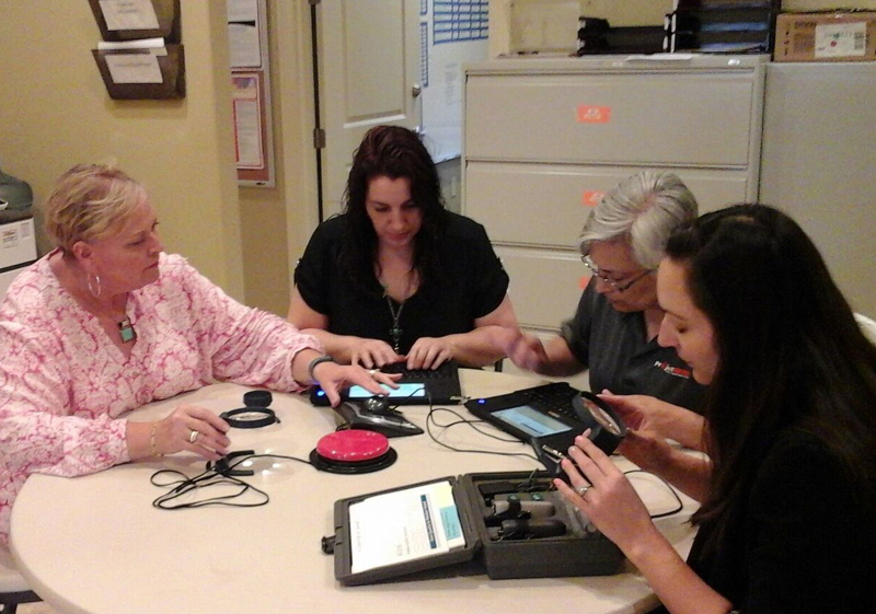 Staff from Project MEND recently participated in a training session on the new technology devices that will be loaned out to people with a variety of disabilities. Photo courtesy of Project MEND.