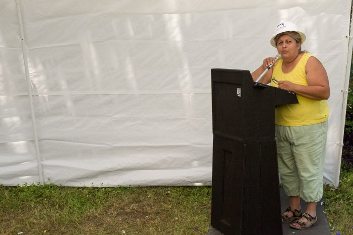 President of the Government Hill Alliance Neighborhood Association Rose Hill speaks immediately after the ground-breaking. Photo by Scott Ball.