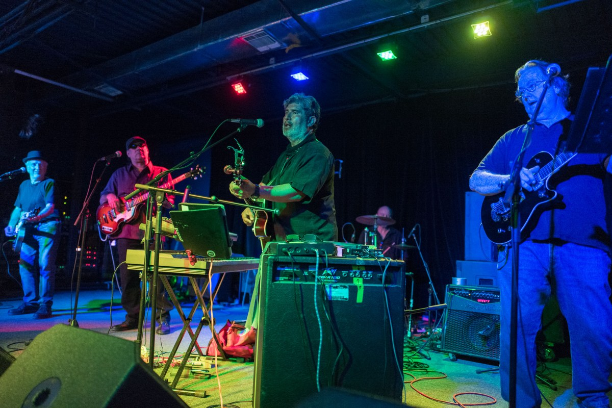 The Blue Note Ringos, a Beatles cover band perform at Paper Tiger. Photo by Scott Ball.