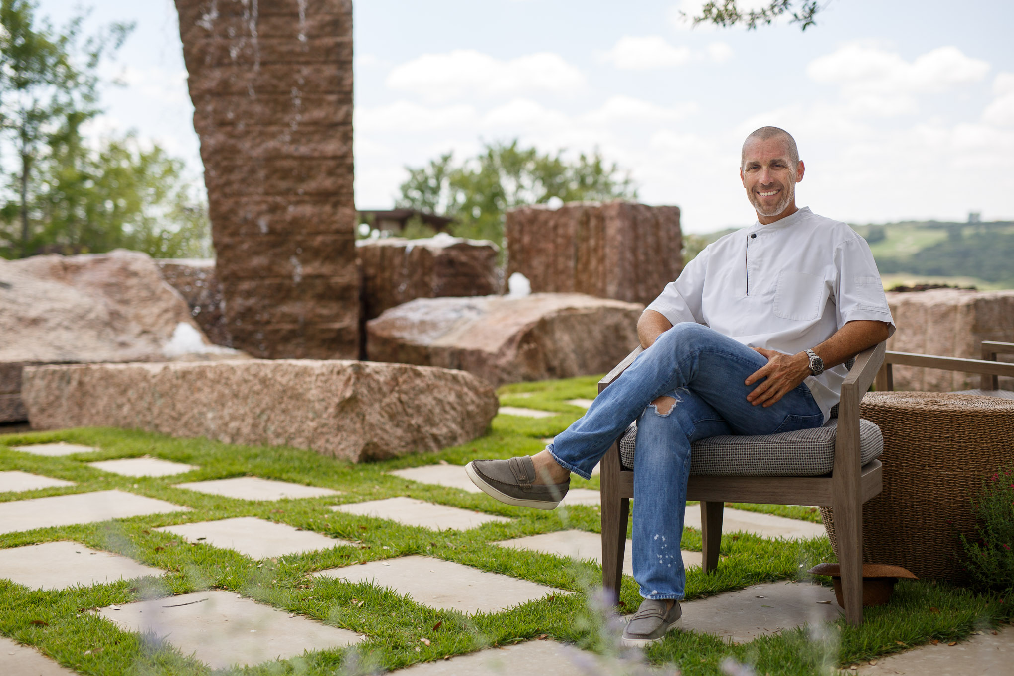 Andrew Weissman sits next a newly constructed fountain at La Cantera Resort & Spa. Photo by Scott Ball.