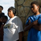 Javonte, 15, looks on during the ceremony of the colors along with his mother Ernestine Armstrong. Photo by Scott Ball.