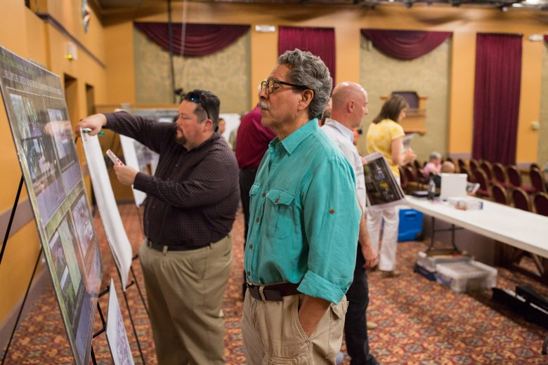 Community member Homer Arias takes a look at proposed Brackenridge plans. Photo by Scott Ball.